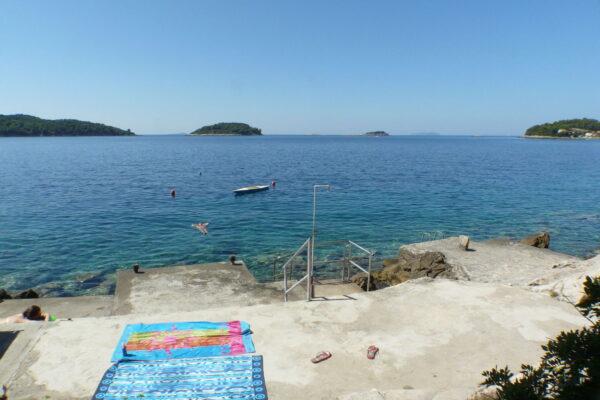 Jelica apartments concrete beach and bright blue sea